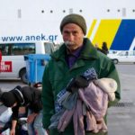 Port of Lesbos, man picking clothes