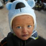 Port of Lesbos, little child with blue eyes
