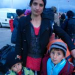 At the port of Lesbos, mother with their children