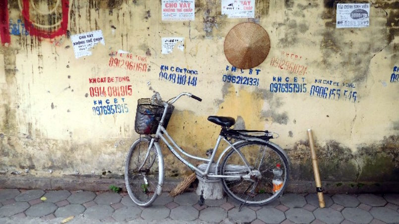 Bicycle and straw hat in Hanoi