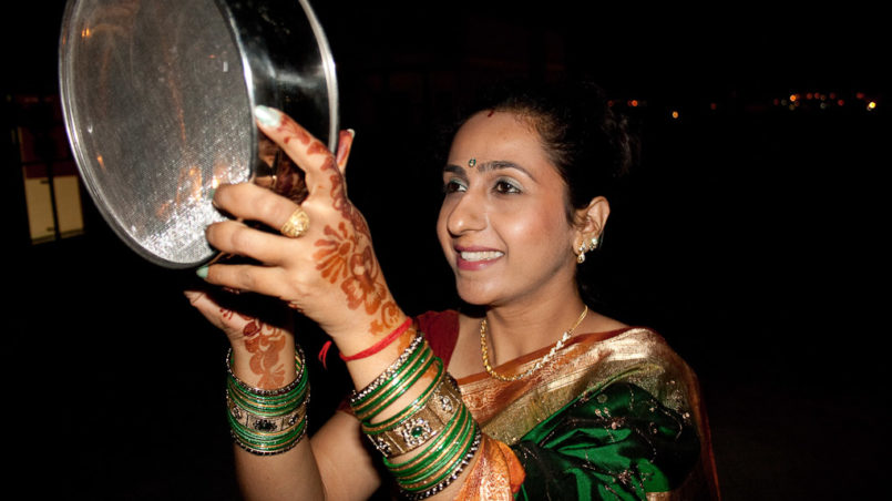 """Karva Chauth"" - Fasting women looking at the moon through a sieve"