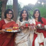 Fasting women holding the puja thali in their hand
