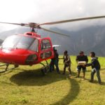 People receiving and taking the emergency relief materials.