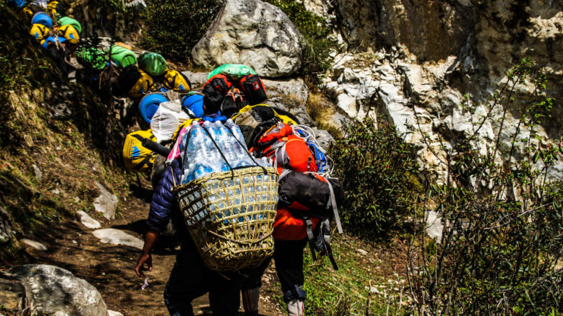 Porters walking in the opposite direction