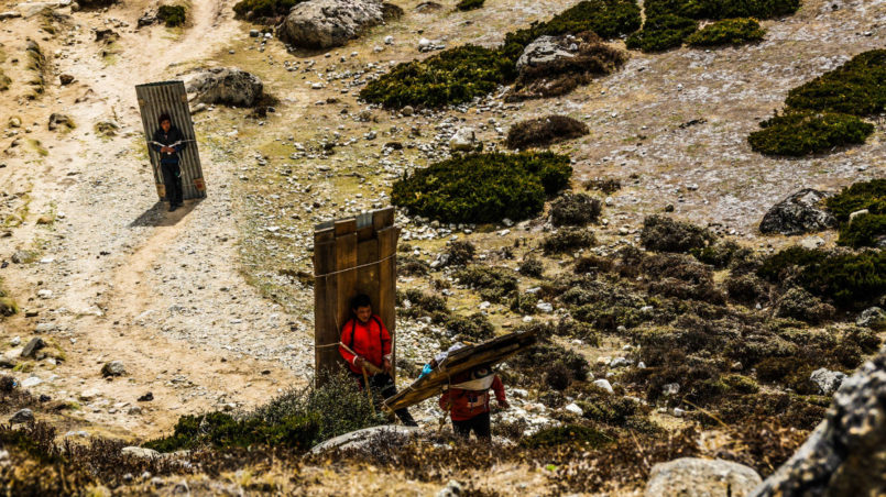 Porters transporting construction materials to Dingboche