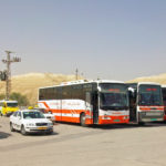 Buses_and_vans_in_parking_lot_on_West_Bank_side_of_Hussein-Allenby_Bridge