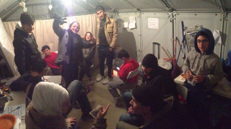 Volunteers and refugees gathered in our hut
