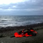 A pile of life jackets on the shore of Lesvos