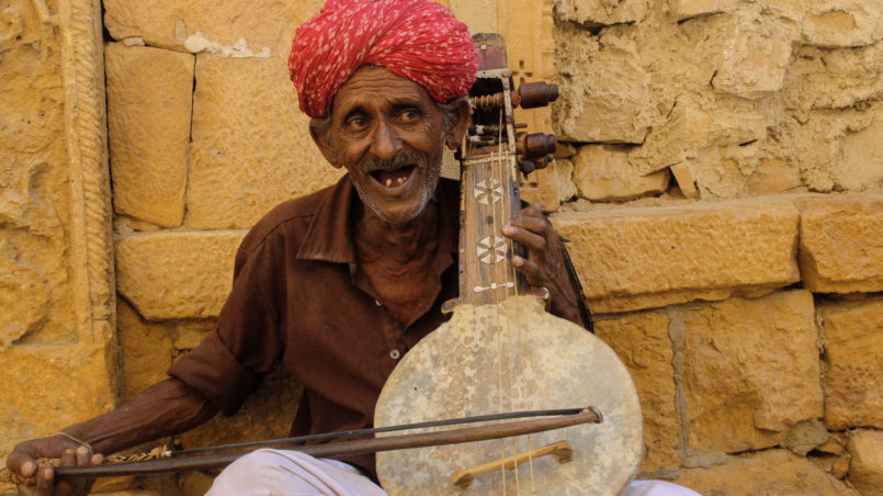 Musician playing the Kamaicha, a traditional string based instrument from Rajasthan-