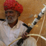 Musician playing the Ravanatthi instrument from Rajasthan-